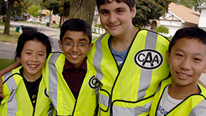 CAA School Safety Patrollers wearing CAA vests ready to make community safe.